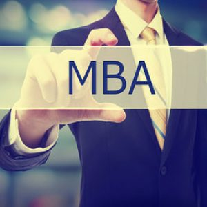 Business man holding MBA